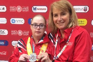 Daughter and mother Lizzie and Sue Williams, pictured with a medal at the Special Olympics World Summer Games in the United Arab Emirates.