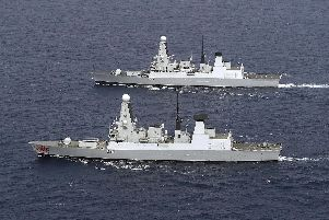 Pictured: HMS Duncan lays side by side with HMS Dragon in the sail past. Photo: Royal Navy