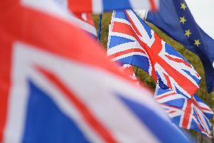 A row of Union flags in a spot usually occupied by EU flags opposite the Houses of Parliament in London's Westminster, the day after MPs held a series of indicative votes on the way forward with Brexit. Photo:  Kirsty O'Connor/PA Wire