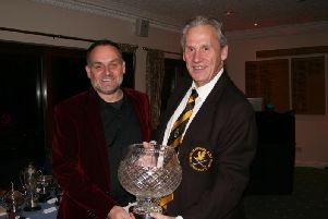 Mark Reynolds receives Leightons 75th Anniversary Trophy from Immediate Past Captain Jeremy Taylor