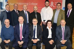SRC Governor John Nugent, Neil Madeley from the Department for the Economy FE Estates department, SRC Director of Client Services Raymond Sloan, SRC Governor Matt Turner, Aaron Shannon from Knox & Clayton Architects, Seanie O'Hare from O'Hare & McGovern Limited and Gary Young, SRC Estates Project Manager.  Pictured in the front row (l-r) are SRC Governor Tom Redmond, SRC Chief Executive Brian Doran, Andrew Saunders, the College's Governing Body Chairman), Breda McAteer from O'Hare & McGovern Limited and Ruairi Lavery, SRC Projects Director.