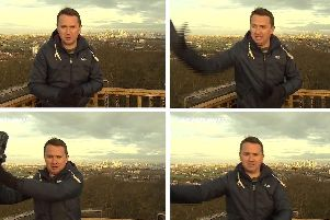 BBC weather presenter Matt Taylor stopping a piece of heavy equipment falling on him during a live broadcast. Picture: BBC/PA Wire