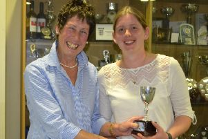 Amie Wright receives the outstanding contribution to the club award (senior) from chairwoman Lesley Ward EMN-190804-111958002