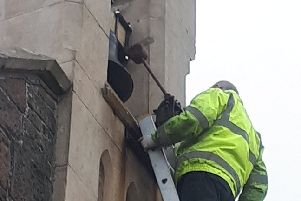 An engineer repositioning the bell hammer at St. John's Church, Glynn.
