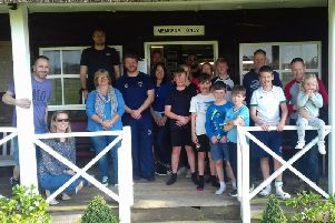 The cricket clean-up team take a breather at the Goodwood pavilion