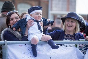 A baby waiting his father to arrive as HMS Dragon returns to Portsmouth. Picture: Habibur Rahman