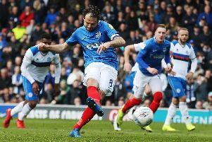 Brett Pitman scores from the penalty spot against Rochdale. Picture: Joe Pepler