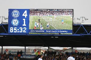 The Fratton Park big screen shows Pompey beating Rochdale and Sunderland losing to Coventry. Picture: Joe Pepler