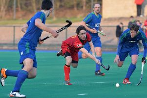 Jamie Wright (centre) helped Banbridge to a vital victory.