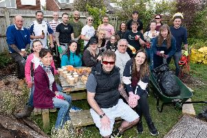 Volunteers with Ricky (centre) and fiancee Clarrisa Knight (centre right). Picture: Duncan Shepherd