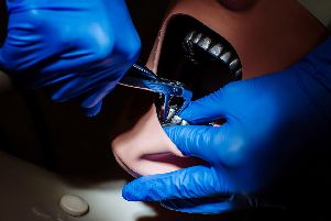 University of Portsmouth Dental Academy students working and training'''