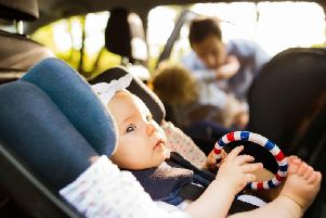 Its far better to find a safe place to park so you can attend to your childs needs properly.