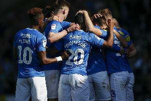 Pompey celebrate Ben Close's opener at Burton. Picture: Joe Pepler
