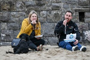 People eat fish and chips. Picture: Ben Birchall/PA Wire