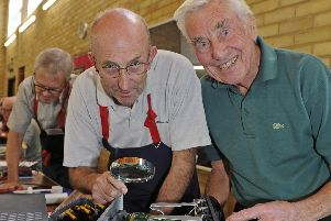 The Portsmouth Repair Cafe celebrates it's first birthday. Jim Fuller, left, takes a look at Ray Jones' hi-fi. Picture: Ian Hargreaves  (200419-2)