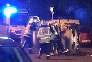 The Nissan Micra on its side in New Road, Copnor, on Sunday night