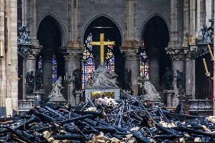 Debris are seen inside Notre Dame cathedral in Paris, Tuesday, April 16, 2019. (Christophe Petit Tesson, Pool via AP)