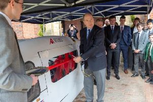 Prince Albert with students and their latest solar car