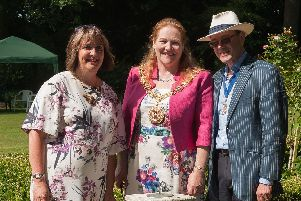 Hill Farm House opened its garden to the public to raise money for the Rowans Hospice in April 2015. (LtoR) Ruth White, from Rowans Hospice, the former Mayor of Winchester Jane Rutter, Duncan Rutter. Picture: Keith Woodland (160005-022)