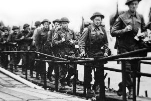 Picture released on June 5, 1944 of the British troops embarking at Southsea, Portsmouth in England, before a landing craft on June 6, 1944 while Allied forces storm the Normandy beaches on D-Day.  / AFP PHOTO / AFP PHOTO AND Imperial War Museum / (Photo credit should read -/AFP/Getty Images)