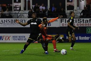 Kazenga LuaLua goes down under a challenge in the area
