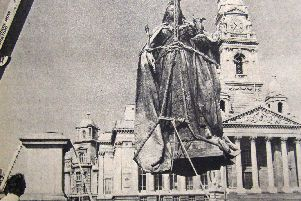 Pictured is the statue beinglifted into place in the square at Guildhall Square.