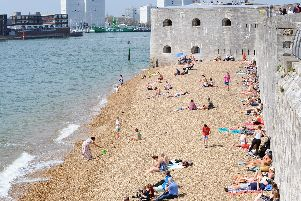 People enjoying the warm weather down at the Hot Walls, Old Portsmouth. Picture: Sarah Standing (190419-5465)
