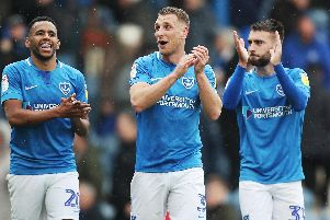 Lee Brown, centre, celebrates with Nathan Thompson, left, and Ben Close. Picture: Joe Pepler