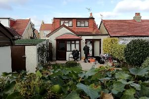 Detectives at the back of the home in Southcroft Road, Gosport after the killing