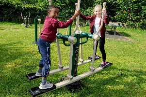 Tyrese Bulze, seven, and Jessica Wise, eight, on the new equipment at Rowner Junior School in Gosport'Picture: Sarah Standing (030519-8024)
