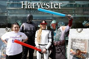 From left, deputy manager Lucy Cross, assistant manager Huw Thomas, Rachael Roberts and Lee Steele dressed as Star Wars characters at Harvester, Whiteley, in aid of Together For Short Lives.     Picture: Chris Moorhouse         (040519-29)