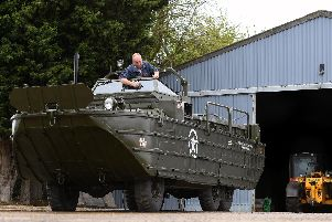 Graham Smitheringale works to restore a DUKW amphibious Second World War vehicle at a farm in Glinton, Peterborough, which he hopes will take part in the D Day 75 commemorations in Portsmouth Picture: Joe Giddens/PA Wire