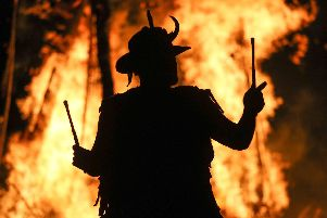 A member of the Pentacle Drummers is silhouetted in front of the burning wickerman during the Beltain Festival, an ancient Celtic celebration to mark the beginning of summer, at Butser Ancient Farm, Waterlooville, Hampshire. PRESS ASSOCIATION Photo. Picture date: Saturday May 4, 2019. Photo credit should read: Andrew Matthews/PA Wire