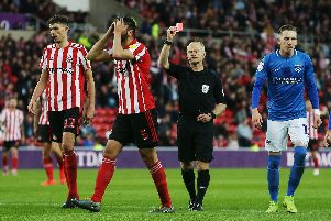 Referee Andy Woolmer shows Alim Ozturk a red card Picture: Joe Pepler