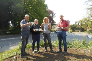 A break for tea during the wild flower seed sowing in Alford.