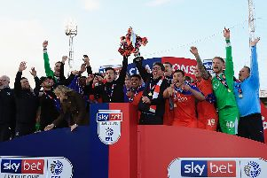 Luton Town celebrate winning the League One title