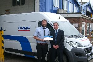 Adams Morey Service Operations Manager, Stan Brimecome receives the prestigious DAF Trucks Service Dealer of the Year Award from Ross Taviner, DAF Trucks After Sales Manager