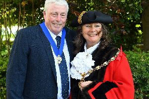 Newly elected Mayor of Gosport Cllr. Kathleen Jones with (left) her husband and now her Consort  Kevin Jones. Picture: Malcolm Wells (190515-9378)