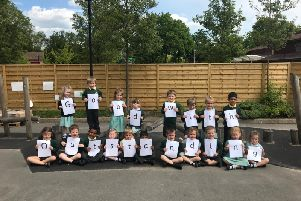 Pupils celebrate Woodloes Primary School's positive Ofsted report.