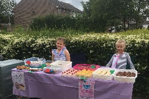 (L to R) Lily Farmer, 7, and Sophie Penny, 7, selling their home baked cakes to help the homeless.