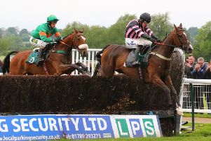 Alltimegold clears the last fence ahead of Agentleman in the Hook Norton Brewery Handicap Chase. Picture: www.dwprattracingphotography.co.uk