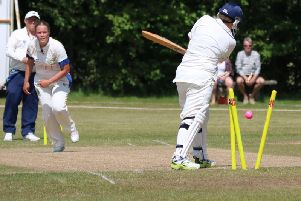 Naomi Woods takes a wicket. Picture by Mark Peacock