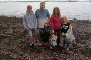 Helen Sarimanolis-Selby and husband Paul Selby with their children, Ethan, 12, and Megan, 8.