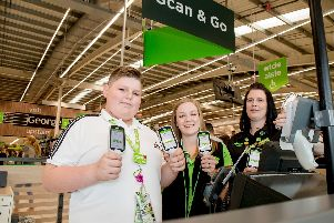 Finley with colleagues Sarah Twine and Dani Dean at Asda in Portsmouth. Picture: Robin Jones/ Digital South