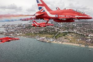 The Ministry of Defence of the Royal Air Force Aerobatic Team, The Red Arrows flying over the commemorations at Southsea Common in Portsmouth for the 75th Anniversary of the D-Day landings.