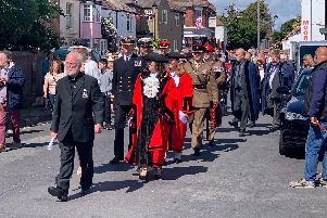 The procession marches down Priory Road for Hardway's D-Day service. Picture: Richard Bourke