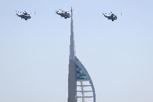 Three Royal Navy Sea King helicopters fly past the Spinnaker tower in Portsmouth, as they approach HMS Sultan ahead of their retirement from military service.' PRESS ASSOCIATION Photo. Picture date: Wednesday September 26, 2018. See PA story DEFENCE SeaKing. Photo credit should read: Andrew Matthews/PA Wire