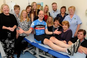 Dr Roger Sutton surrounded by staff from the Staunton surgery when he had his legs waxed for charity in 2017'Picture: Sarah Standing (170582-6960)