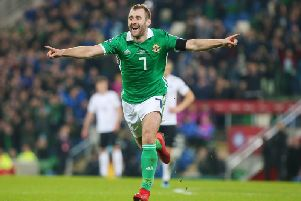 Niall McGinn celebrates scoring against Estonia at Windsor Park last March.