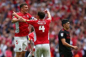 Jason Pearce and Krystian Bielik of Charlton Athletic celebrate at the final whistle during the Sky Bet League One Play-off Final (Photo by Charlie Crowhurst/Getty Images)